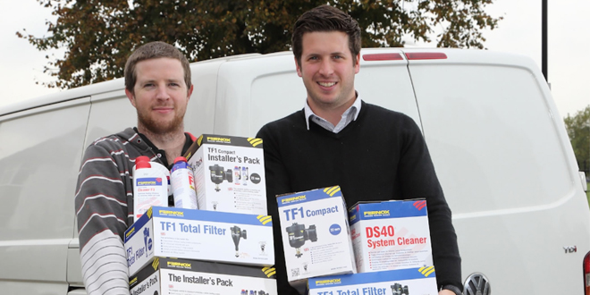 Duncan Rawlings gets his prize from Mike Skivington, Fernox Area Sales Manager