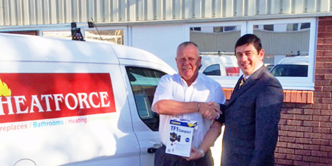 Paul Maddocks (L) receives his Fernox bundle of products from Adam Daly, Southern Sales Director at Fernox