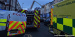 Two people rushed to hospital after becoming trapped in rubble following suspected gas explosion