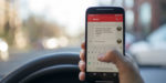 The Government should consider tougher restrictions on driving while using a mobile phone – says MPs